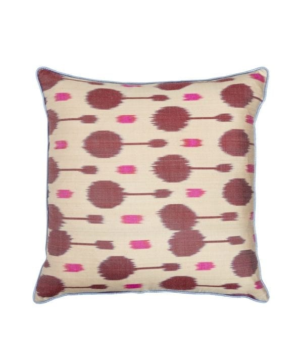 A pink and plum spotted silk ikat cushion from Telescope Style.