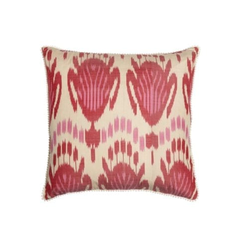 A 50cm x 50cm silk ikat cushion in pink and red.