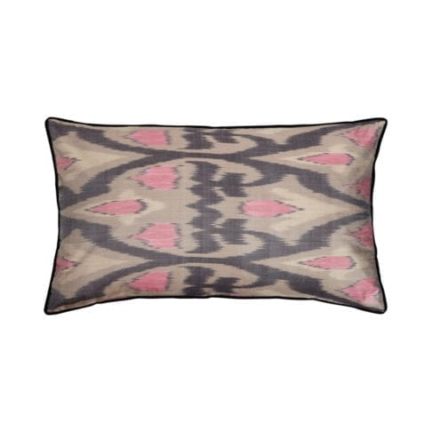 A rectangular pink and warm, grey, silk ikat cushion with black accents.