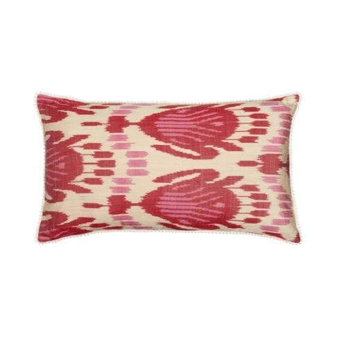 A 40cm x 60cm silk ikat cushion in pink and red.