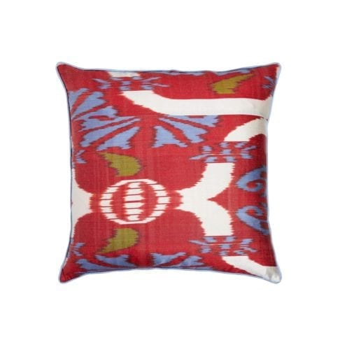 A red, blue and green ikat cushion measuring 50 x 50cm from Telescope Style.