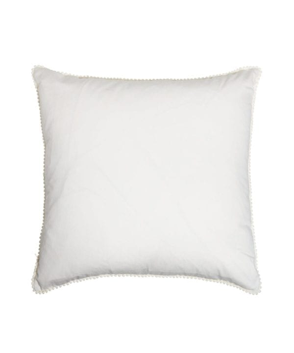 The white cotton back of the square ikat cushions with ivory miniature bobble trim.