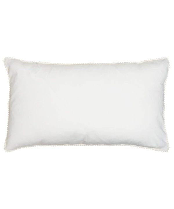 The white cotton back of the rectangular ikat cushions with ivory miniature bobble trim.