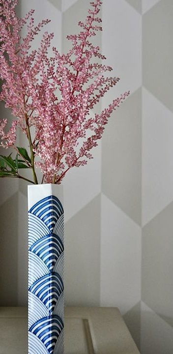 A hand-painted, blue and white Japanese bud vase with waves design.