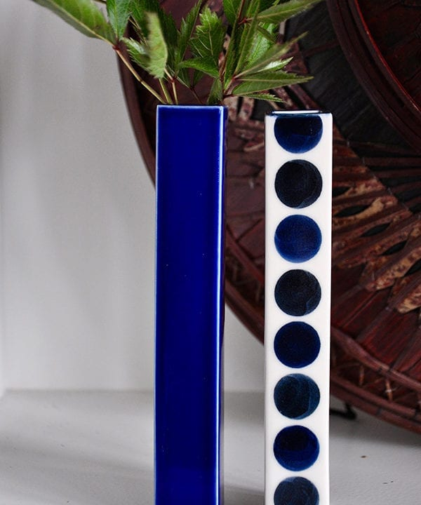 Japanese blue bud vases with polka dot and plain decoration.