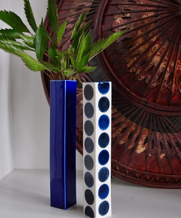 Japanese blue vases in polka dot and plain against a vintage Asian conical hat.