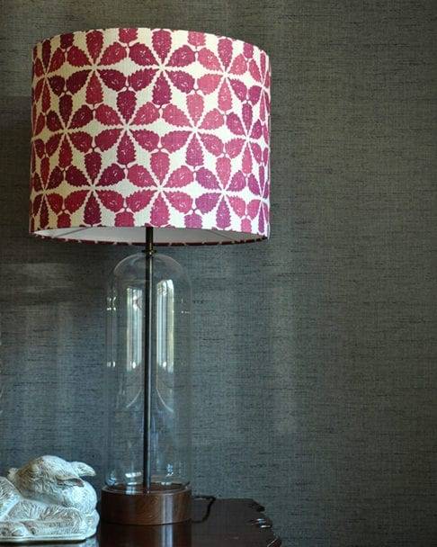 Cranberry red lampshade in 'Maroc', against a grey backdrop, Telescope Style.