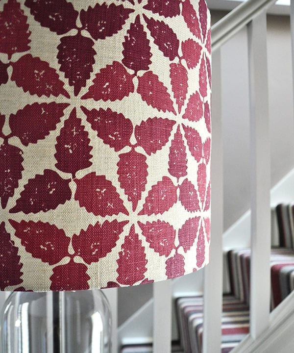 Close-up shot of a red patterned lampshade in 'Maroc'.