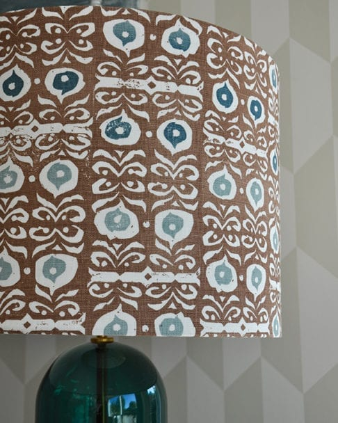 Detail of a teal blue and brown patterned lampshade.
