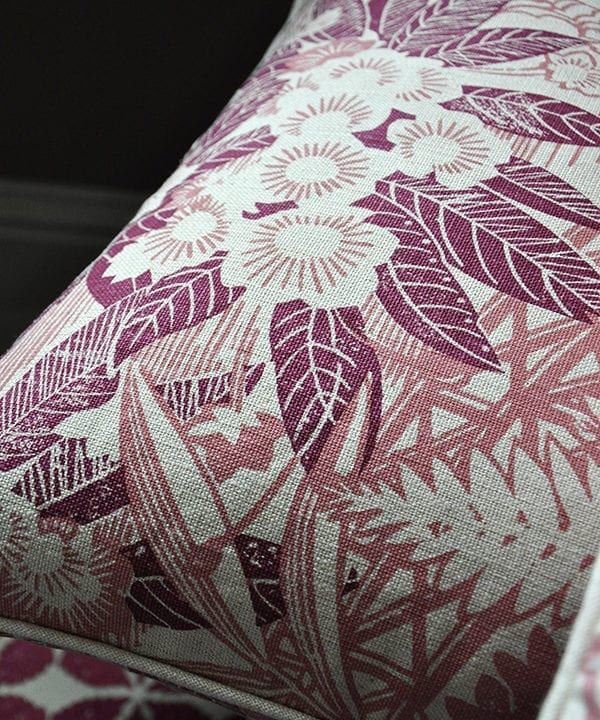 A close-up shot of Webb's Wonder printed linen pink floral cushion in the raspberry colourway from Telescope Style.