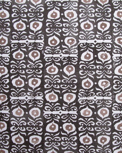 Iznik handprinted linen in inky-black kohl and taupe patterned cushion fabric close-up..