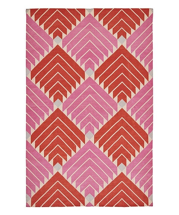 A flèche design flatweave rug in scarlet and bubblegum pink from Telescope Style.