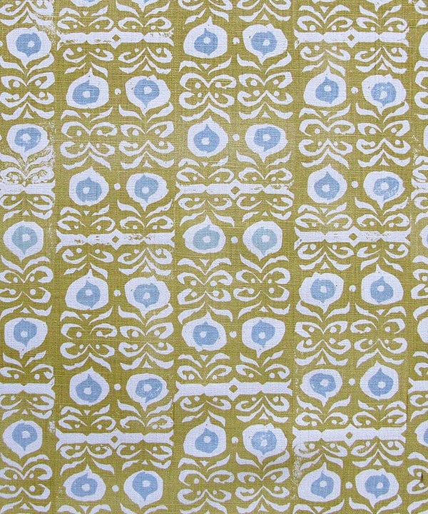 A close-up fabric shot of Iznik yellow patterned cushions in the Old Gold colourway available from Telescope Style.