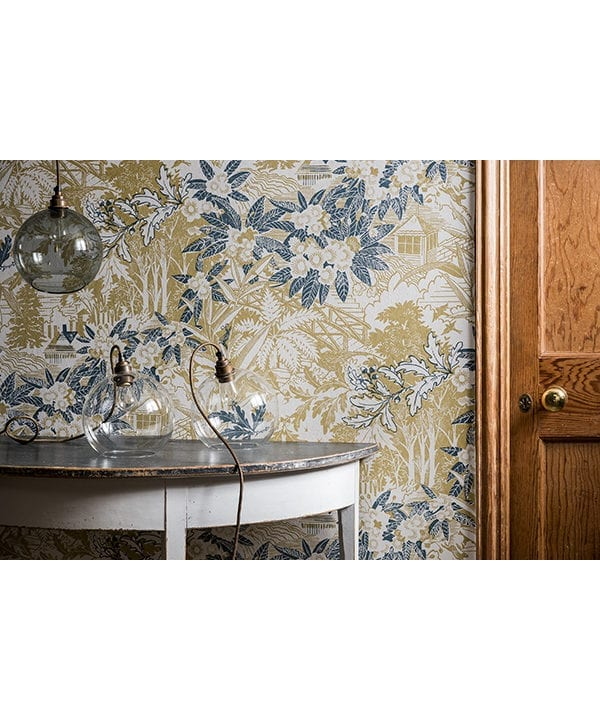 Styled shot of Webb's Wonder wallpaper in the chartreuse colourway to give an idea of pattern scale.