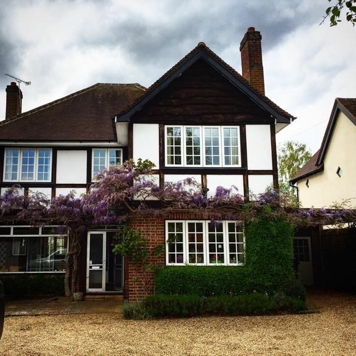 An original, wisteria-clad, 1930s house with 1970/80s additions.