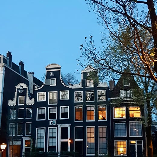 Amsterdam canal houses at dusk from the Telescoe Style blog, Holland in Springtime.