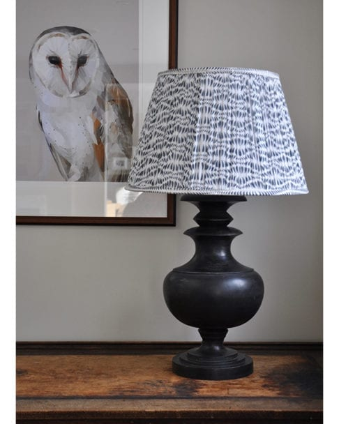 Grey patterned lampshades in block-printed cotton voile.