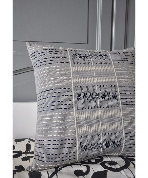 Square, grey cushions with hand-woven detailing from Nagaland in India. Available through Telescope Style.
