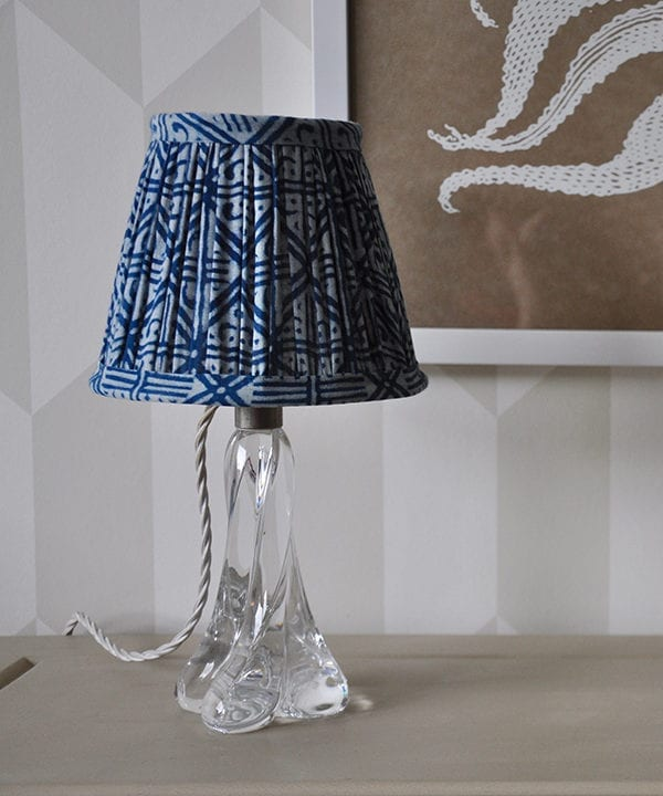 Close-up shot of a petite indigo lampshade with a geometric grid design.