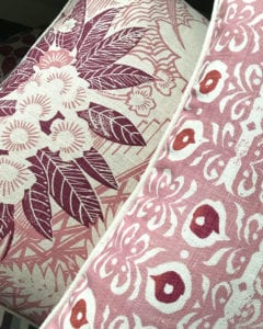Rapture and Wright hand-printed pink linen cushions available through Telescope Style.