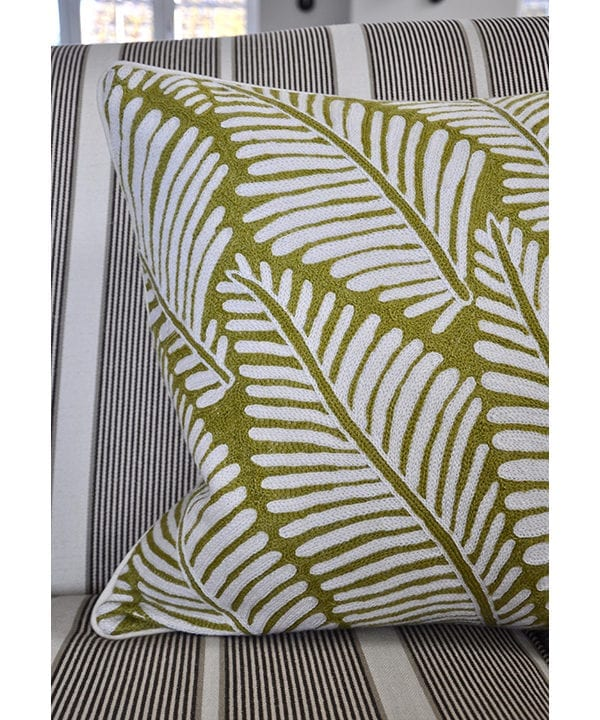 A chartreuse design cushion, handmade in Indian Kashmiri crewelwork, available from Telescope Style.