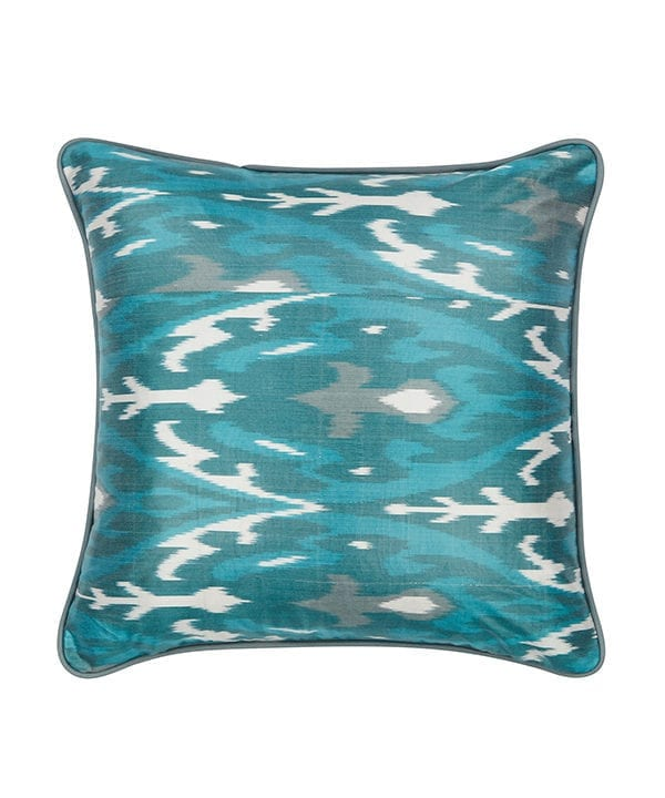Cut out shots of teal ikat cushions from Telescope Style.