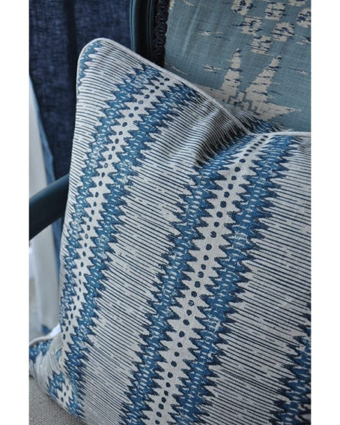 Close-up of a hand-printed, linen, blue striped cushion in a tribal design.