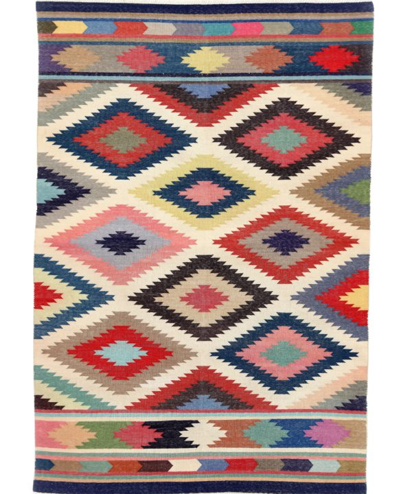 A multi-coloured rug in a vibrant, geometric diamond design reminiscent of Aztec culture.