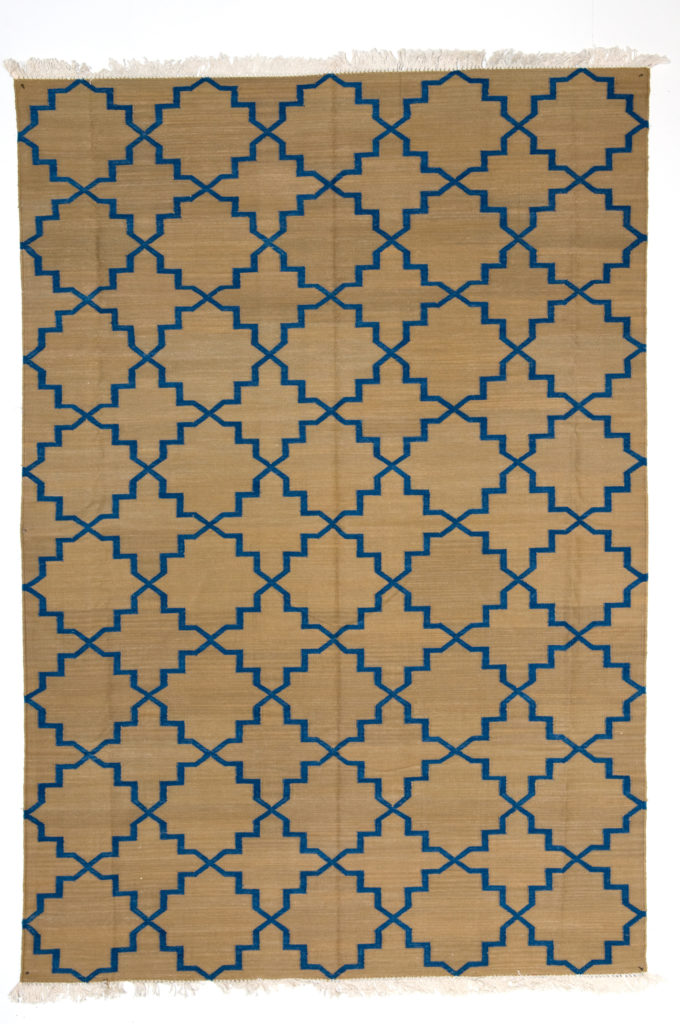 Blue dhurrie rug with pattern inspired by jali-screens, from Telescope Style.