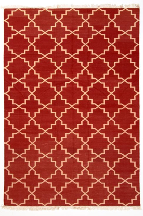 A deep red dhurrie rug with a cream lattice design.