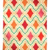 Pink and orange rug with vibrant diamond motif, handmade in India for Telescope Style.
