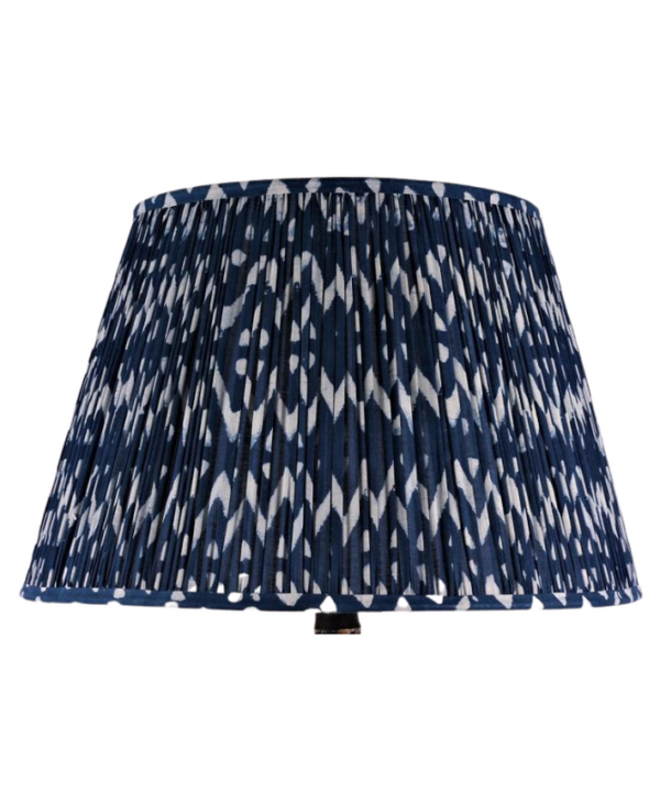 Cut out shot of zig-zag block-print cotton lampshades in indigo.