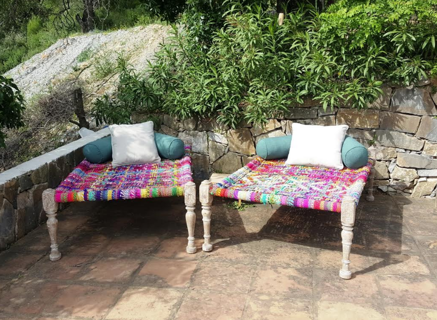 Colourful Indian 'Charpoy' day beds made from re-purposed saree fabric available from Mahout Lifestyle.