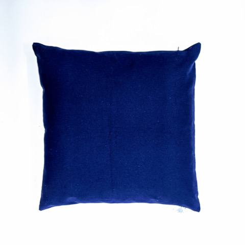 The canvas reverse of a vintage indigo flower circles cushion from Telescope Style.