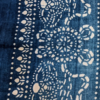 Detail of a rectangular, vintage, indigo, striped, linen cushion cover from Telescope Style.