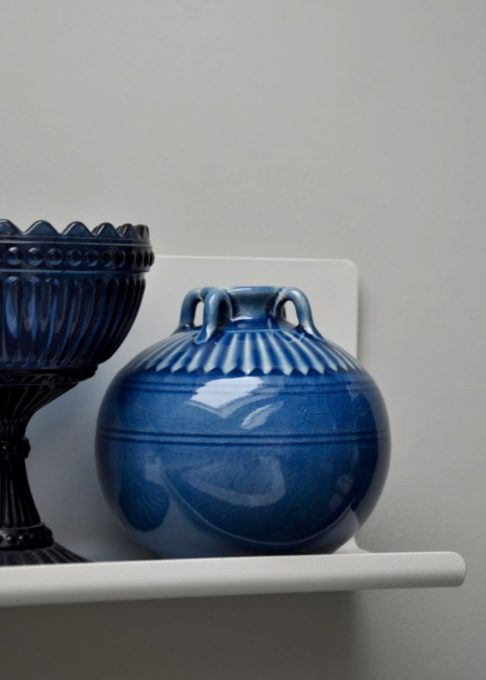 A small, blue, ceramic pot handmade in northern Thailand from Telescope Style.