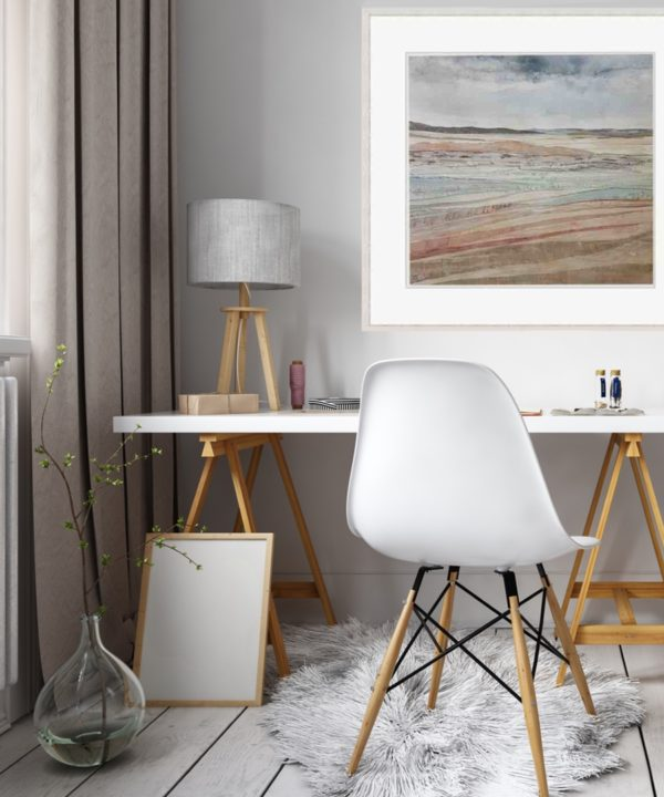 Irish coastal wall art print Dunes At Murlough Bay framed and styled in a home office setting with a modern white desk with wooden trestles, white chair and table lamp.