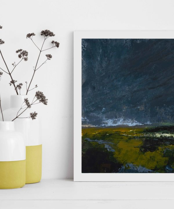 Framed Irish art print Dusk Is Here styled next to yellow pots filled with meadow flowers.