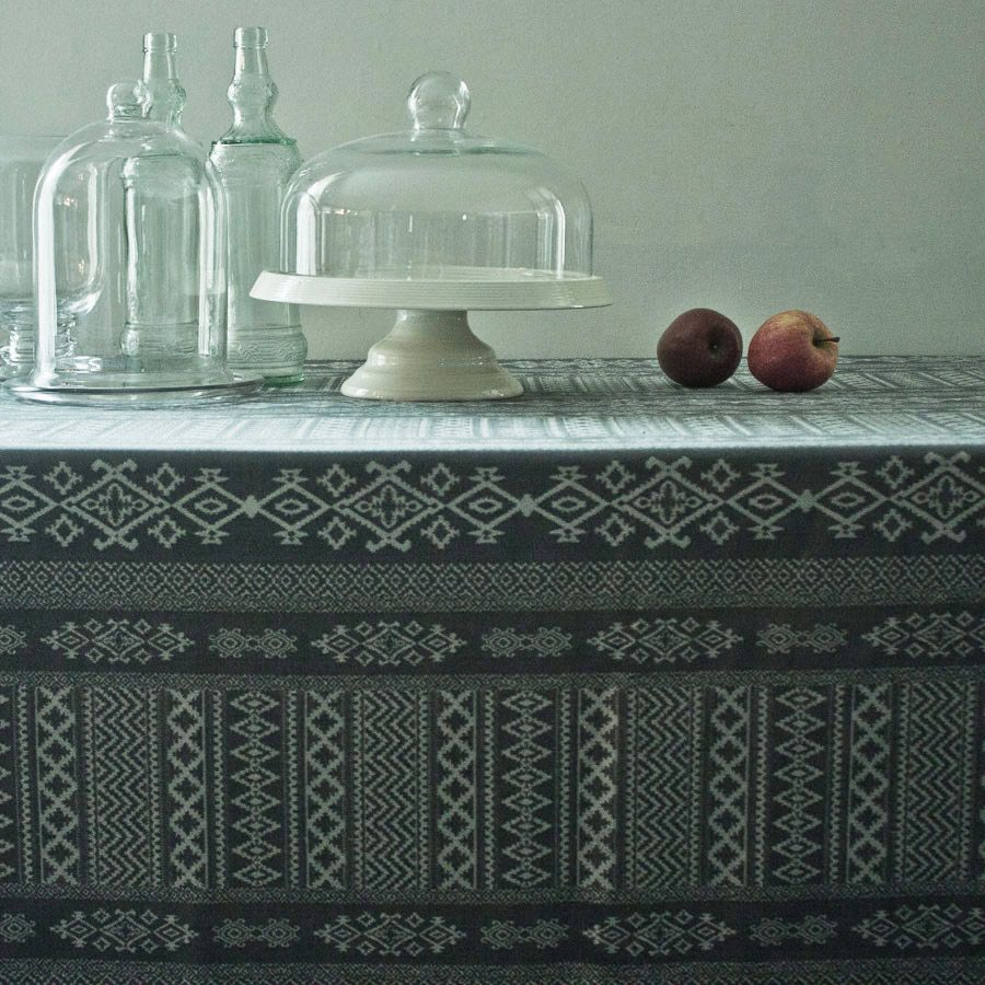 Charcoal grey tablecloth closeup depicting Arabian architectural motifs.