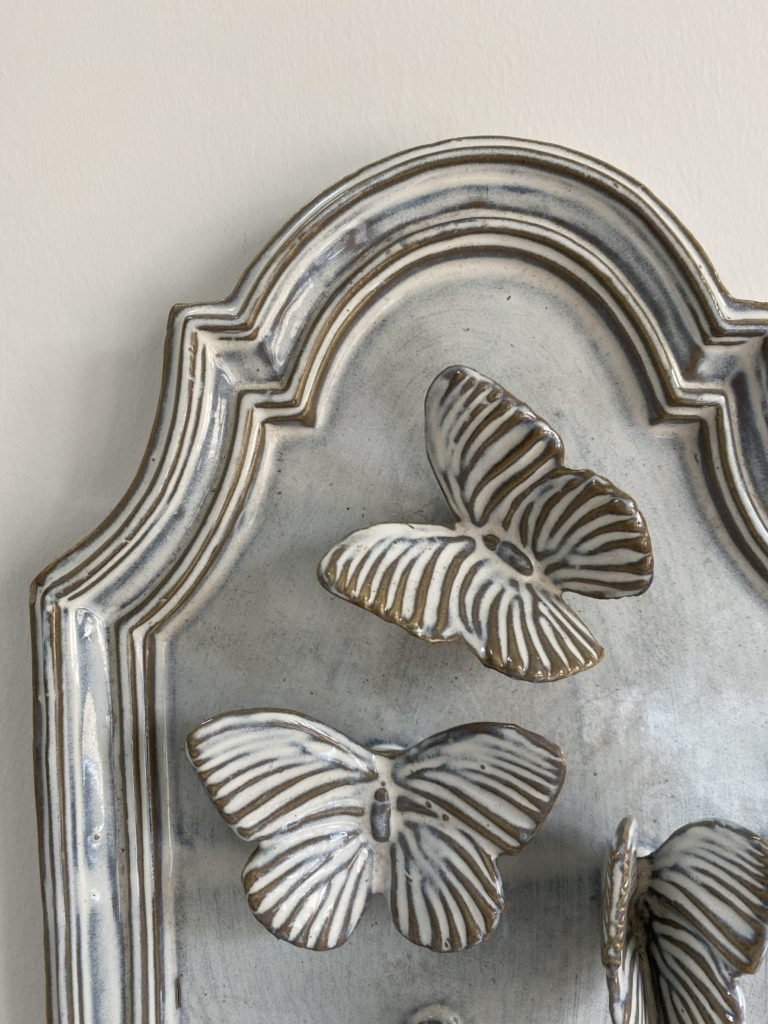 Butterfly wall art 3D ceramic plaque detail.