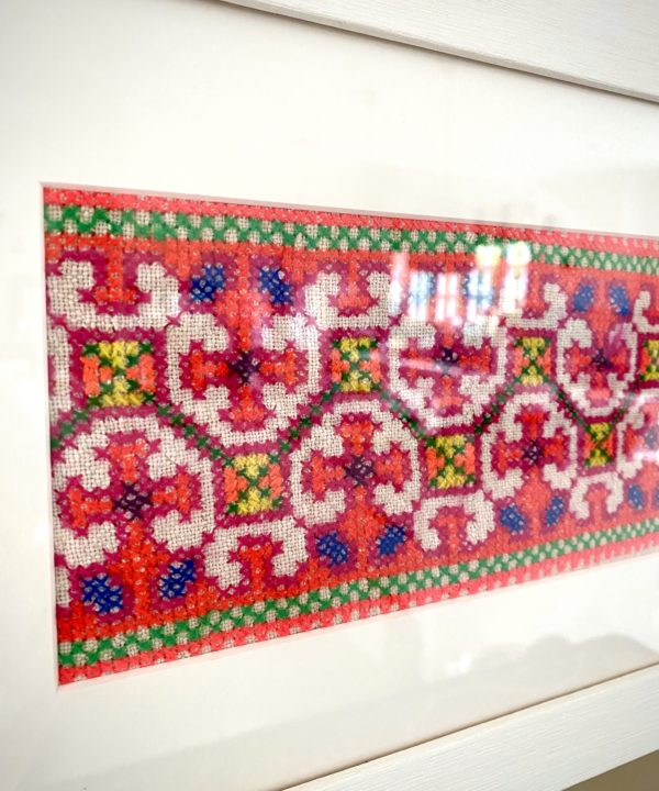 Framed fabric wall art showcasing a panel of hand-embroidered Thai textile, sourced in north of the country.
