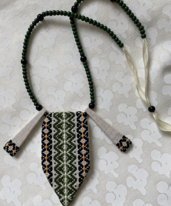 Beaded Boho statement embroidered necklace in green, black and gold with cream ribbon.