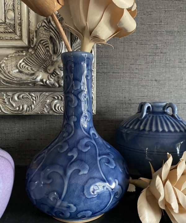 Blue ceramic pot handmade in northern Thailand displayed against a grey backdrop.