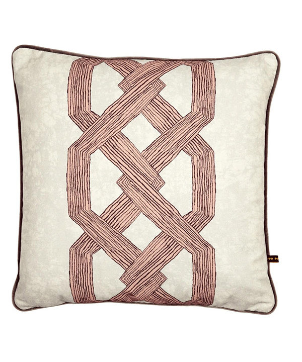 Statement pink cushion covers with a bold, architectural and African-style motif.