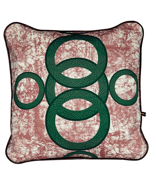 A red and green cushion with West African-inspired concentric circles motif.