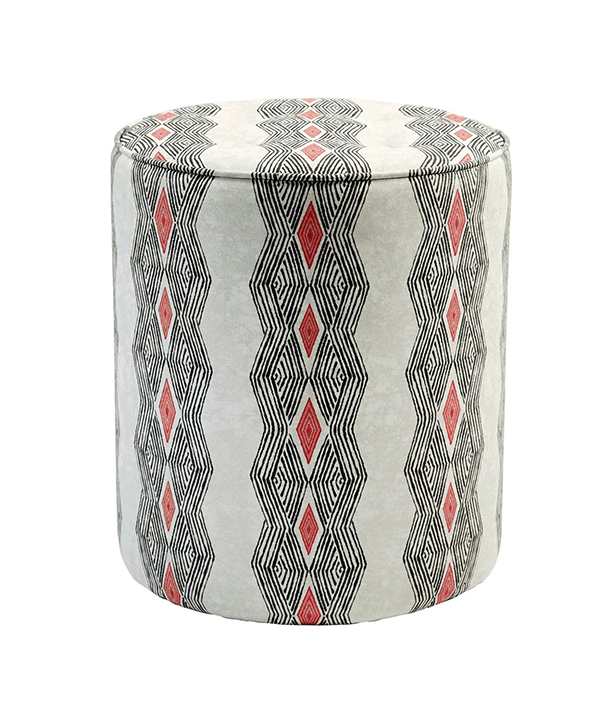 African fabric print footstool in black and red tribal stripe design.