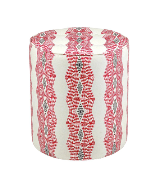 A red pouffe with African geometric stripe fabric.