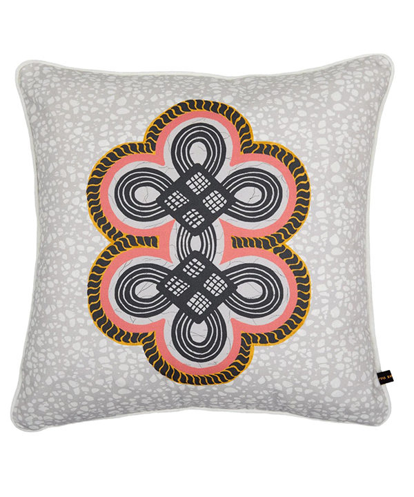 African print cushion covers with a coral double knot motif on a grey ground.