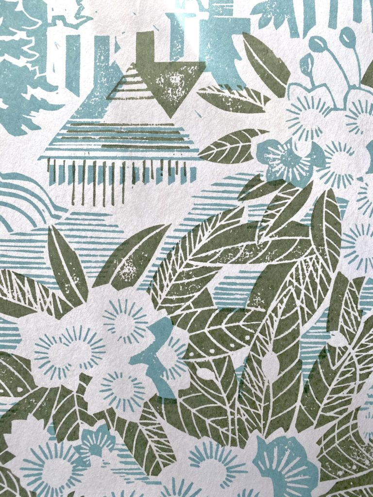 An elegant, country house wallpaper with an Arts & Crafts feel by Rapture and Wright, in a duck egg blue and khaki green colour way.