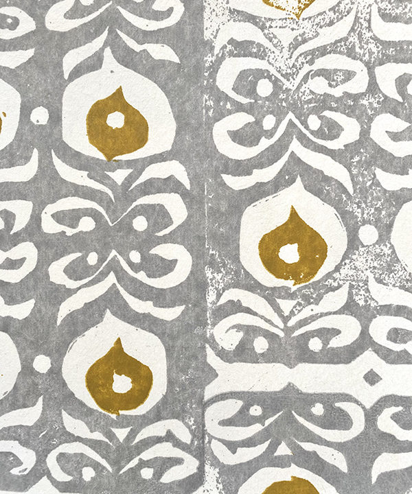 Chic, mustard and grey wallpaper, hand-printed in England but inspired by ceramic detailing from the Middle East.